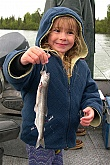 Child Holding Fish: Picture of Young Girl Holding Fish - Hooligan